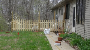 Fence going up at back patio.